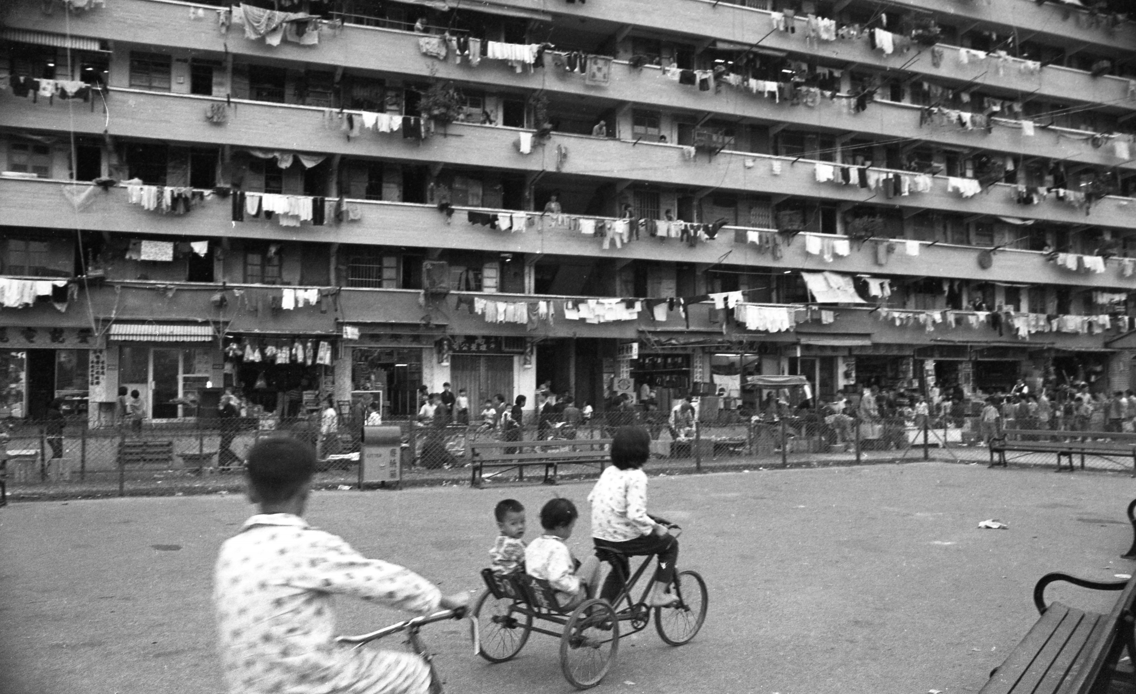 EXCLUSIVELY FEATURED BY EASTPRO - hong kong 1969 - chaiwan public housing estate - kids riding tricycle